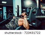 very strong bearded man doing... | Shutterstock . vector #723431722