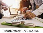 business team meeting present... | Shutterstock . vector #723466756