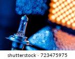 halogen car bulb on yellow led... | Shutterstock . vector #723475975