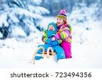 little girl and boy enjoy a... | Shutterstock . vector #723494356