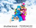 little girl and boy enjoy a... | Shutterstock . vector #723524122