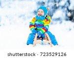 little boy enjoying a sleigh... | Shutterstock . vector #723529126