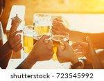 happy friends drinking beer and ... | Shutterstock . vector #723545992