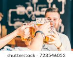 happy friends drinking beer and ... | Shutterstock . vector #723546052