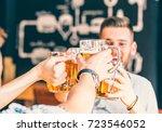 happy friends drinking beer and ... | Shutterstock . vector #723546052