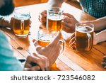happy friends drinking beer and ... | Shutterstock . vector #723546082