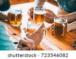 happy friends drinking beer and ...   Shutterstock . vector #723546082