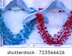beads of blue and red handmade... | Shutterstock . vector #723566626