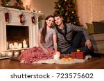 a young couple sitting together ... | Shutterstock . vector #723575602