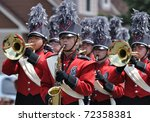 OSSEO, MN - JUNE 26 : Richfield High School Marching Band Perform in the Osseo Marching Band Festival on June 26, 2010 in Osseo, MN - stock photo