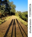 long shadows of three people on ... | Shutterstock . vector #723588526