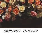 Stock photo rose background colorful cloth roses on black background 723603982