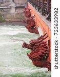 Red Dragon Heads On A Bridge I...