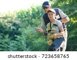 father teaching son how to fly... | Shutterstock . vector #723658765