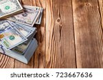 money isolated on a wooden... | Shutterstock . vector #723667636