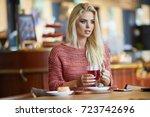 young fashion woman drinks tea... | Shutterstock . vector #723742696