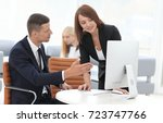 employees discussing business... | Shutterstock . vector #723747766
