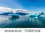 an oddly shaped iceberg... | Shutterstock . vector #723837628