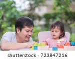 asian father and daughter are... | Shutterstock . vector #723847216