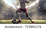 soccer player kicks the ball on ... | Shutterstock . vector #723881176