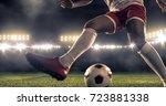 soccer player kicks the ball on ... | Shutterstock . vector #723881338