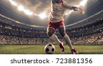 soccer player kicks the ball on ... | Shutterstock . vector #723881356