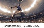soccer player kicks the ball on ... | Shutterstock . vector #723892222