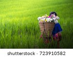 Small photo of Hmong tribe woman with flowers seat on ack in rice field