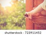 women hand open door knob or... | Shutterstock . vector #723911452