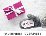 pink gift  glove  text relax | Shutterstock . vector #723924856