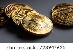 golden shining bitcoins on a...   Shutterstock . vector #723942625