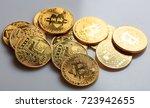 golden shining bitcoins on a...   Shutterstock . vector #723942655