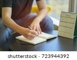 stressed planner sitting on... | Shutterstock . vector #723944392