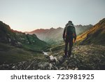 man hiking at sunset mountains... | Shutterstock . vector #723981925