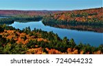 The beautiful colors of Autumn around Rock Lake in Algonquin Provincial Park, Ontario, Canada.