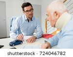 Small photo of personal injury lawyer in meeting with client wearing neck brace
