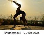 girl is doing exercises near... | Shutterstock . vector #724063036