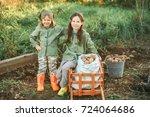 the children on the harvest of... | Shutterstock . vector #724064686