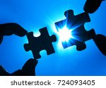 two hands trying to connect... | Shutterstock . vector #724093405