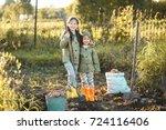 the children on the harvest of... | Shutterstock . vector #724116406