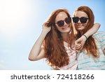 two red head twins wearing... | Shutterstock . vector #724118266