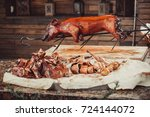 whole grilled pig with meat... | Shutterstock . vector #724144072