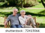 senior couple sitting on a bench | Shutterstock . vector #72415066