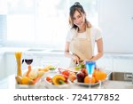 Small photo of Asian wife prepare salad and spaghetti for parrty dinner in kitchen room
