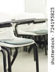 empty chair in classroom | Shutterstock . vector #724195825