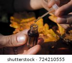 a woman opens the perfume oil.... | Shutterstock . vector #724210555
