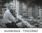 grandfather with a dog of the... | Shutterstock . vector #724223062