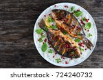 grilled whole fish loaded with... | Shutterstock . vector #724240732