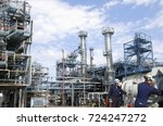 refinery workers with machinery ... | Shutterstock . vector #724247272