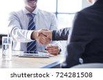 business handshake in the office | Shutterstock . vector #724281508